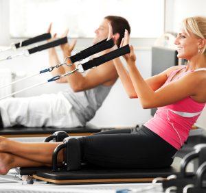 Two people doing Pilates exercises.   [url=http://www.istockphoto.com/search/lightbox/9786766][img]http://dl.dropbox.com/u/40117171/sport.jpg[/img][/url]